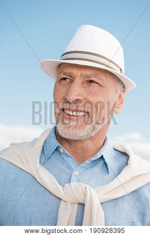 Portrait Of Grey Haired Stylish Man Smiling And Looking Away