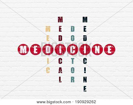 Medicine concept: Painted red word Medicine in solving Crossword Puzzle