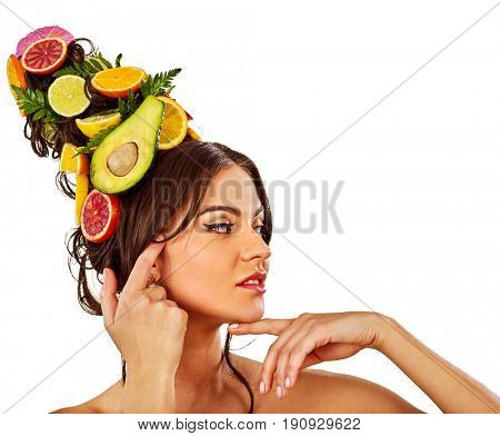 Hair and facial mask from fresh fruits for woman concept. Girl care her skin homemade by dint of organic therapy on isolated. Woman in profile is testing new diet with vitamins for hair.