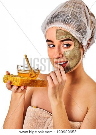 Facial honey clay face mask for woman . Honeycombs natural homemade organic threatment. Skincare health concept on isolated. Manufacture of confectionery products.