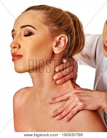 Shoulder and neck massage for woman in spa salon. Doctor making neck therapy in rehabilitation center. Repositioning of joint in clinic. Correction of dislocation of neck by experienced specialist. poster
