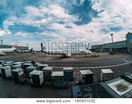 MOSCOW, RUSSIA - May 29, 2017: Moscow Domodedovo International airport terminal, passenger airplane, Crates with cargo, view from waiting zone area