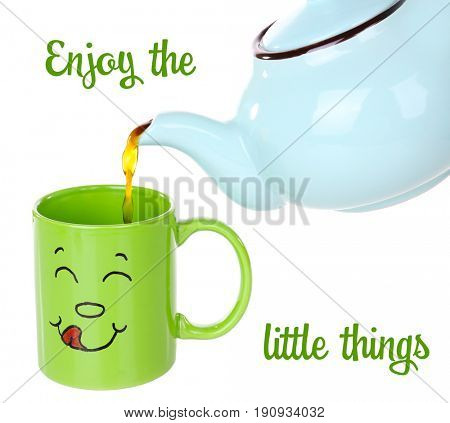 Text ENJOY THE LITTLE THINGS and pouring tea into cup with funny face on white background