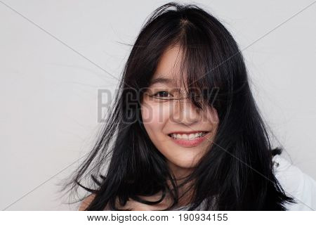 Eye Of Asian Girl With Hair In Wind