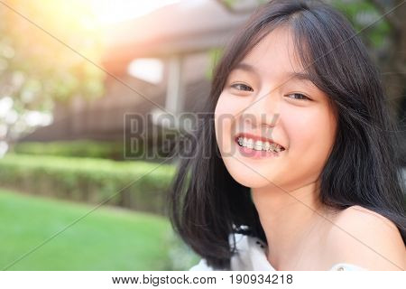 Cute Asian Girl Teenage Model In Park