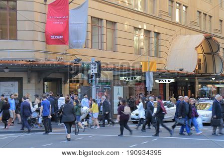 SYDNEY AUSTRALIA - JUNE 1, 2017: Unidentified people cross street in front of Myer department store.