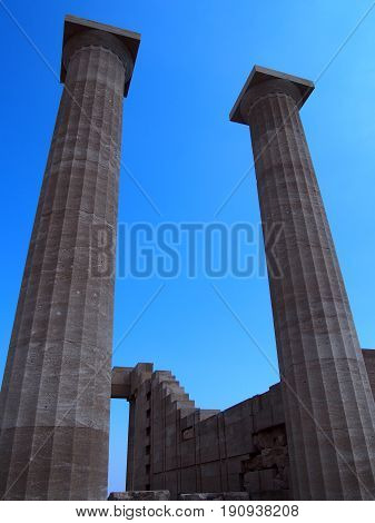 columns of the acropolis in lindos rhodes with blue sky in summer
