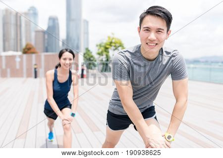 Woman and man doing warm up exercise in Hong Kong