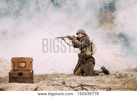 Gomel, Belarus - November 26, 2016: Re-enactor Dressed As Red Army Russian Soldier Of WWII Aiming With Rifle On Battlefield. Celebration Of 73rd Anniversary Of Liberation Of Gomel From Nazi Invaders