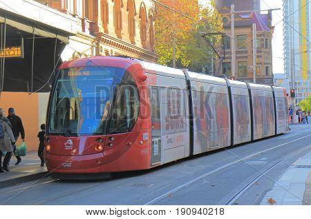 SYDNEY AUSTRALIA - JUNE 1, 2017: Unidentified people travel by light rail train in downtown Sydney.