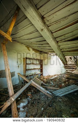 The Interior Of Ruined Abandoned Private Country House With Caved Roof In Evacuation Zone After Chernobyl Disaster. Terrible Consequences Of The Nuclear Contamination.