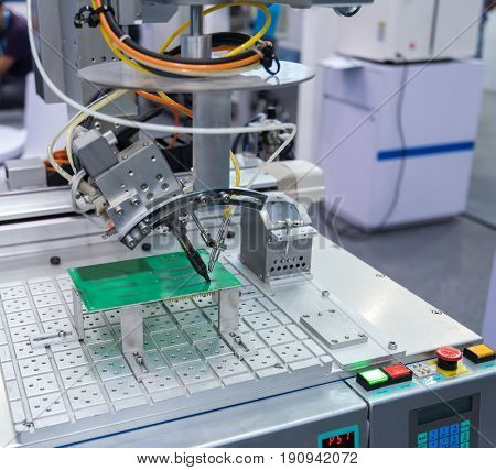 Robot Welding in assembly line working in factory. Smart factory industry 4.0 concept.
