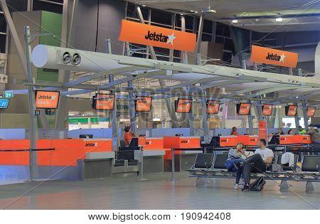 SYDNEY AUSTRALIA - JUNE 1, 2017: Unidentified people wait at Jetstar check in counter Sydney Airport.