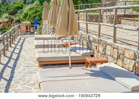 Solarium on a stone-paved terrace on the island of Crete Greece