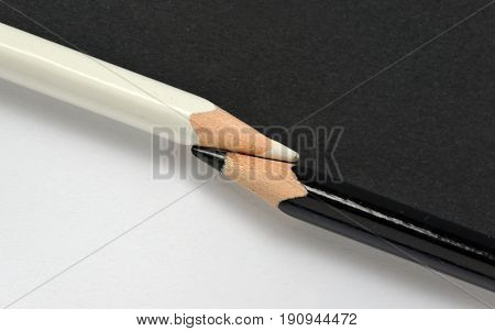 abstract black and white crayons on the same paper background