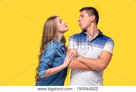 The conflict of couple - Woman shouting to man at they looking on each other