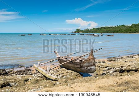 Traditional pirogue on the shore of Nosy Be island in Madagascar Africa. Focus on the foreground.
