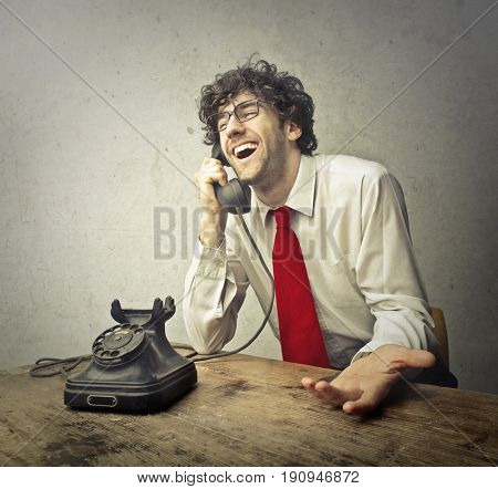 Young businessman with red tie on a phone conversation