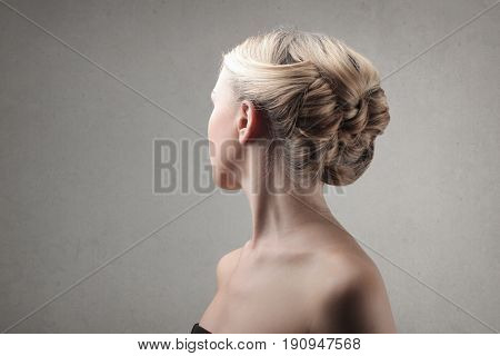 Braided updo hairstyle on a blonde woman
