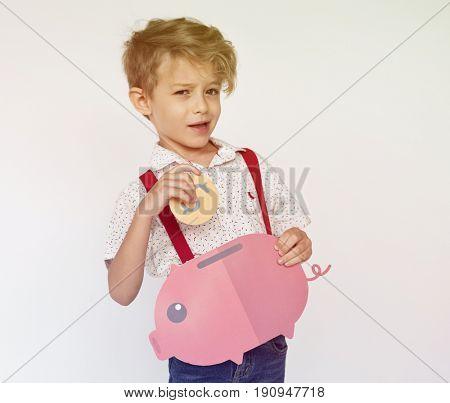 Kid Holding Piggy bank Saving Money