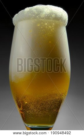A glass of sparkling delicious beer alcohol, ale, amber