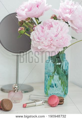 Bouquet Of Pink Peonies In A Vase. Bouquet Of Peonies In A Vase, Macaroon, Cosmetics On The Table. D