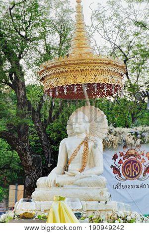 Bangkok, Thailand - December 4, 2015: Buddha white statue with offerings in Sanam Luang, Bangkok, Thailand.