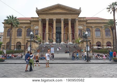 PALERMO, ITALY - JUNE 2, 2017: tourists in front of famous opera house Teatro Massimo in Palermo, Sicily, Italy. It is the biggest in Italy, and one of the largest of Europe.