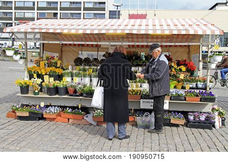 Man Is Selling Flowers Outdoor In Turku, Finland