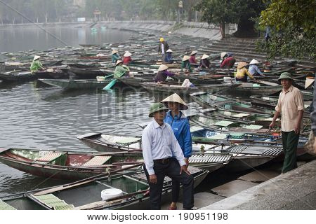Tam Coc, Ninh Binh, Vietnam - March 16, 2017: Wooden boats waiting for tourists at the river in Tam coc, Ninh Binh, Vietnam