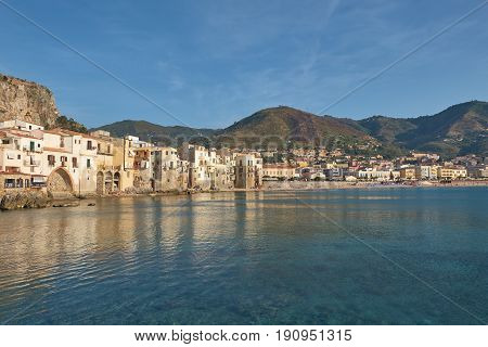 View on habour and old houses in cefalu at sunset sicily beautiful townscape of old italian town