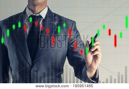 Businessman is pointing on growth up hologram chart graph business background.