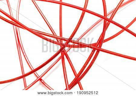 red wire on a white background . A photo