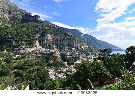 Hills and sea cliffs surround the village of Positano in Italy.