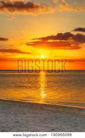 White sandy beach Le Morn  at sunset. Mauritius.