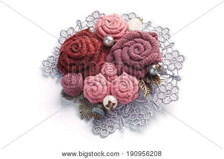 Stylish handmade brooch consisting of pink flowers from fabric on a white background