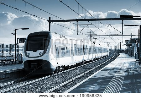 Electric Passenger Train Goes Near Railway Platform