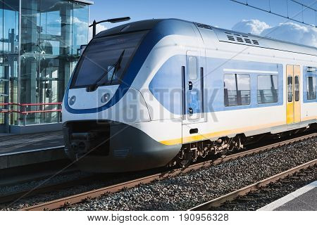 Electric Train Goes Near Railway Platform