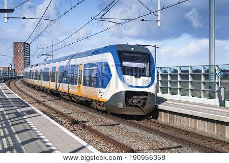 Passenger Electric Train Goes Near Railway Platform