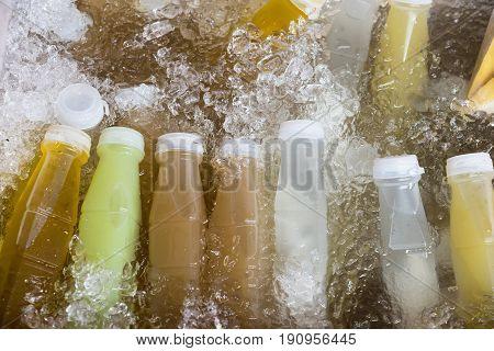 Bottle Of Fruit Juice In Ice Bucket In Food Market At Bangkok, Thailand