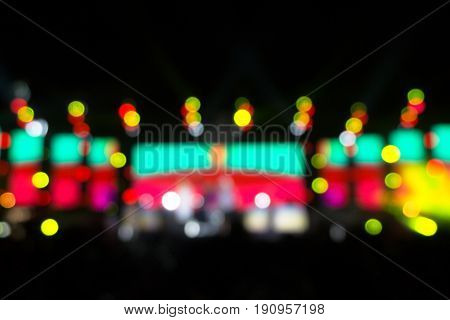 Defocused entertainment concert lighting on stage Festival event party night lights blurred abstract colorful bokeh background. multi color blur bokeh concert stage party at night.
