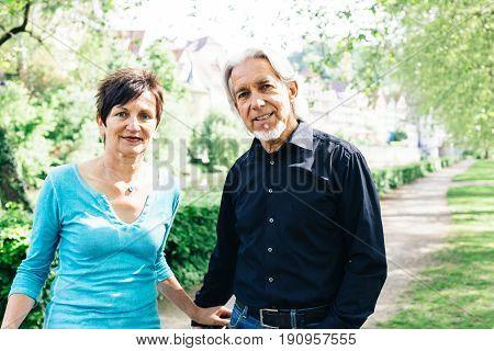 Senior couple walking through a park, Neckarinsel, Tuebingen, Germany