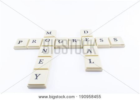 Progress money and business written with crossword form on a white background.