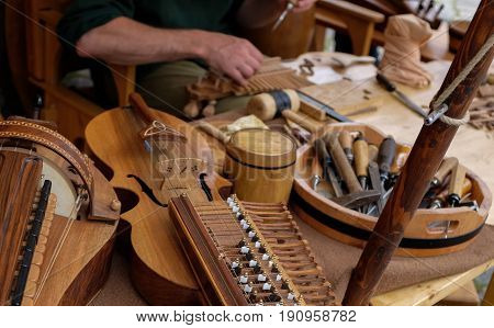 An instrument maker in making wooden musical instruments