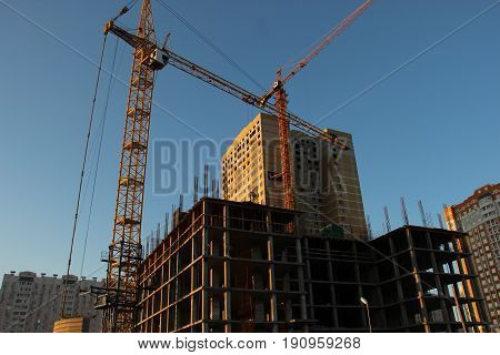 Building Of A Of A Multi-storey Residential Building With Two Tower Cranes. Construction Of A Monoli