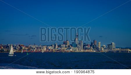 AUCKLAND, NEW ZEALAND- MAY 12, 2017: Beautiful view of the largest and most populous urban area in the country, with yatch sailing, in a sunny beautiful day in the horizon.
