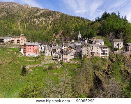 Landscape of little village in Alps mounts