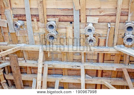Wooden mold for fountain with reinforced dry concrete and flanges.