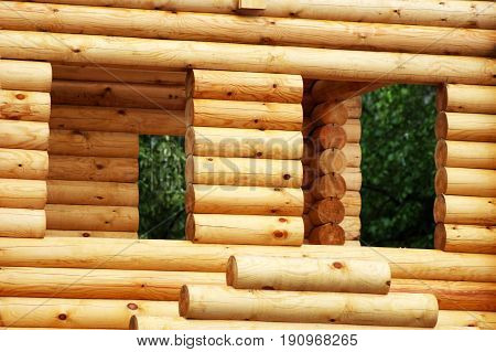 Closeup view of corner of wooden house made of natural logs