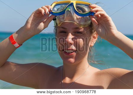 A Young Woman In A Mask For Scuba Diving Laughs, A Large Portrait. The Concept Of A Hilarious And Ex